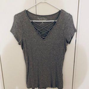 grey v neck shirt